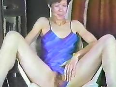 A hairy girl spreads her legs and fingers her big bush