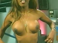 Smutty ebony babe flaunts her fake tits in enchanting backstage compilation