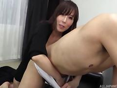 Sexy Japanese milf slips a finger in his ass during a handjob