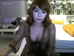 Cute Japanese girl is posing and washing on her home webcam