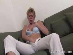 Blonde mature spreading pink cunt