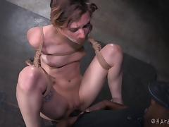 Crazy bondage and caning for this pretty girl in his dungeon