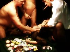 Dirty whore gets gangbanged on a poker table by three fuckers