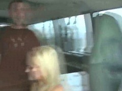Blonde chick fucks two guys in a van