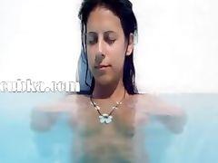 Naughty girl fingering in the pool
