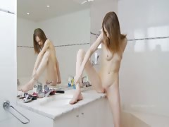 Beautiful sknny coed teasing for mirror