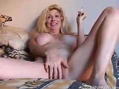 Beautiful blonde milf enjoys a smoke naked