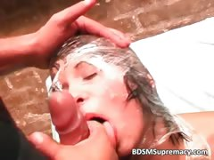 Messy BDSM threesome play where brunette