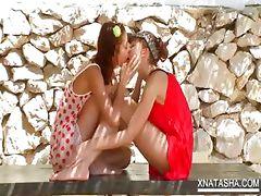 Teen lesbian duo shares a double dildo