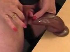 Mature masturbates big clit with black dildo