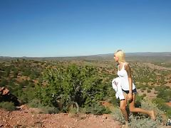 Skinny Emma Mae masturbates in in the middle of a rocky desert