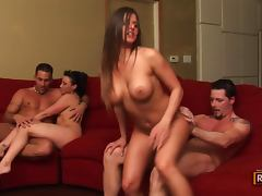 Two Sexy Busty Wives Swap Husbands on a Red Couch