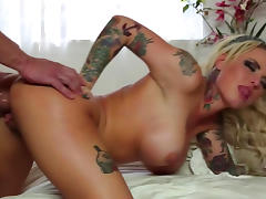 Tattooed beauty Christy Mack is riding on the dick