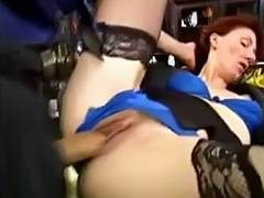 MILF with sexy red hair is fucked by her younger lover