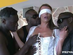 Blindfolded Brunette Caroline Tosca Surprised with Three Big Black Cocks