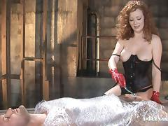 Curly-haired mistress Audrey Hollander enjoys anal sex in a shed
