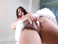 Brunette hottie pumps her pussy before stuffing it with a dildo
